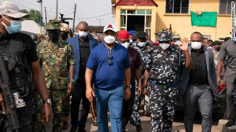 Imo state Gov. Hope Uzodinma, center, inspects the scene of an attack at the police command headquarters in Owerri, Nigeria, on Monday, April 5, 2021.
