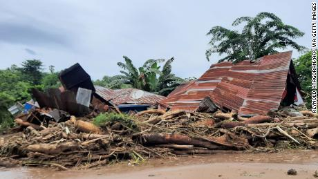 Homes damaged by flash floods in Waiwearng village, East Flores, Indonesia, on April 5.