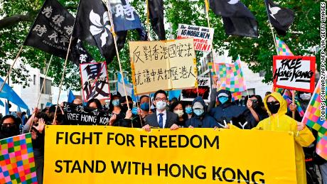 Hong Kong democracy activist Nathan Law (C) takes part in a demonstration in Berlin, Germany on September 1, 2020.