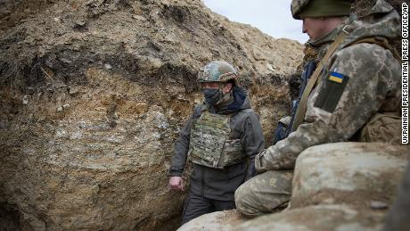 Ukraine's President heads to the trenches as Russia masses its troops