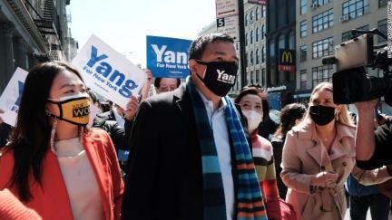 New York mayoral candidate Andrew Yang speaks to members of the media along Canal Street in Chinatown on April 5, 2021, in New York City.