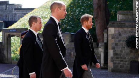 From left, Philip's grandsons Peter Phillips, Prince William and Prince Harry take part in the funeral procession.