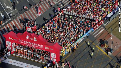 It's become almost a cliche to point out how much China has returned to normality, but this image of hundreds of mask-less people preparing to run a marathon in Huaian, Jiangsu province, on April 18 is still striking.