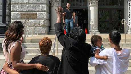 Dixon smiles outside Erie County Court in Buffalo, N.Y.