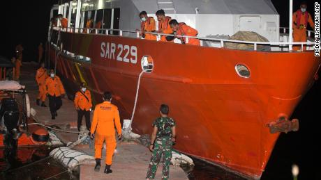 Members of the National Search and Rescue Agency (BASARNAS) are preparing Wednesday for the search mission for the KRI Nanggala-402 in the port of Benoa in Bali, Indonesia.