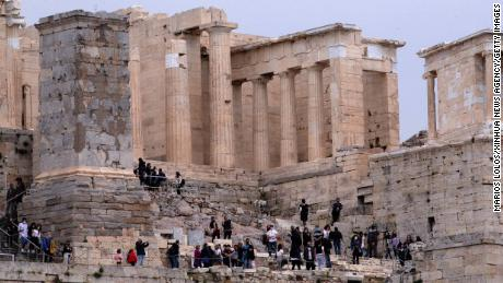 People visit the Acropolis in Athens, Greece, on April 18. Archaeological sites were opened to the public for the International Day for Monuments and Sites.