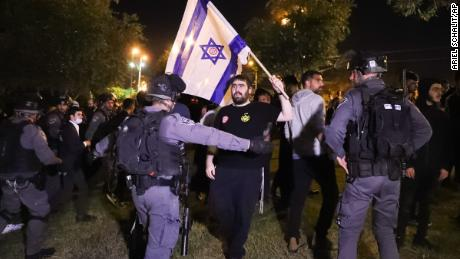 Israeli border police block members of Lehava, a Jewish extremist group, near Damascus Gate amid heightened tensions in the city.