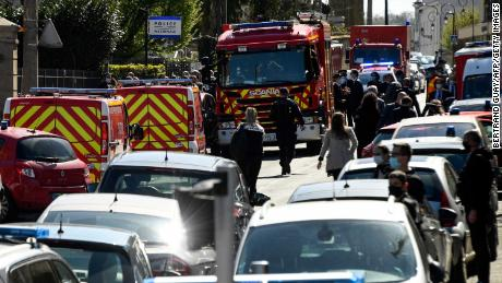 French police officials and firefighters at the station in Rambouillet.