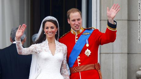 The newlyweds waved to crowds from the balcony of Buckingham Palace, London, on their wedding day.