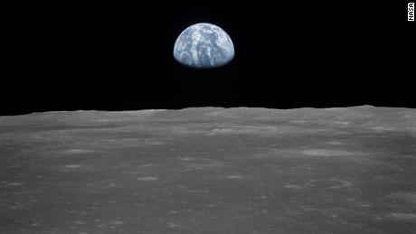 This view of Earth rising over the moon's horizon was taken from the Apollo 11 spacecraft. T
