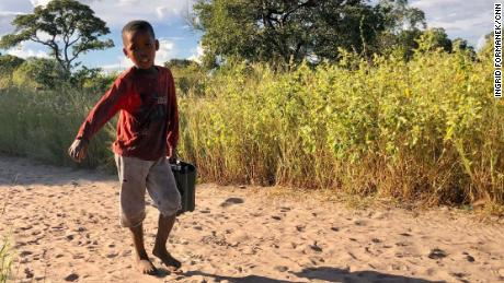 In the San village, children carry water from a nearby borehole. Activists and scientists fear that a large-scale oil industry here could pollute the ground water. ReconAfrica says their practices won't lead to water pollution.
