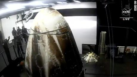 Astronauts inside the capsule prepared to exit