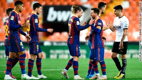 Barcelona players celebrate after the final whistle.