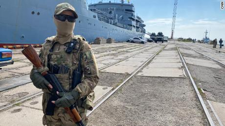 A Ukrainian marine stands guard in the port of Mariupol.