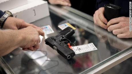 A customer purchases a gun at Freddie Bear Sports on April 08, 2021 in Tinley Park, Illinois.