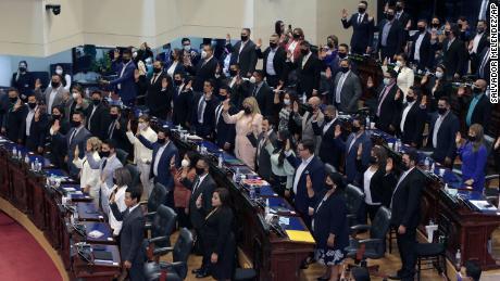 Ruling party New Ideas lawmakers are sworn-in at the Congress in San Salvador, El Salvador, Saturday, May 1, 2021.