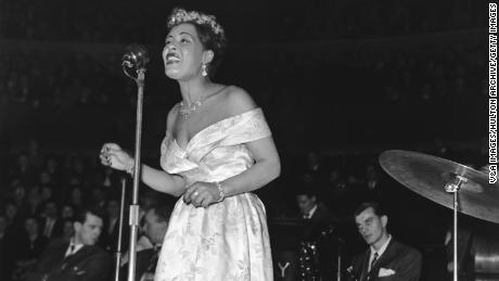 Billie Holiday performs on stage on February 14, 1954.