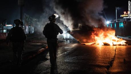Israeli police patrol during clashes between Arab and Jewish citizens in Lod on Wednesday.
