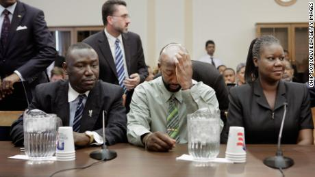 The parents of Trayvon Martin -- Tracy Martin, center, and Sybrina Fulton -- with Ben Crump at a House Judiciary Committee briefing on March 27, 2012, in Washington.