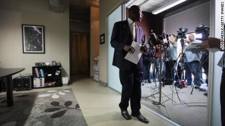 Benjamin Crump leaves the microphones on March 20, 2012, after speaking with the media in Fort Launderdale, Florida, about his clients' son, 17-year-old Trayvon Martin, who was killed on February 26 of that year.