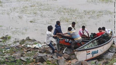 Fishermen pull  boats to shore during Cyclone Tauktae in Mahuva, Gujarat, India, on May 18.