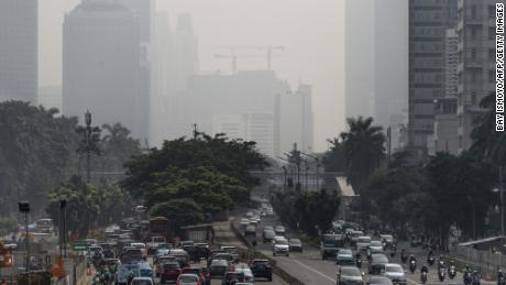 Buildings in downtown Jakarta are shrouded in a thick haze made worse by fires burning in rural provinces around the region on February 23, 2018.
