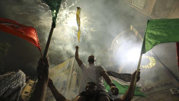 Palestinians celebrate in the West Bank city of Ramallah on Friday, after the ceasefire was agreed.