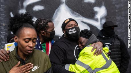 """People hug at George Floyd Square in Minneapolis on April 20. It was after a jury found former police officer Derek Chauvin <a href=""""https://www.cnn.com/2021/04/20/us/derek-chauvin-trial-george-floyd-deliberations/index.html"""" target=""""_blank"""">guilty of murdering Floyd.</a>"""
