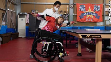 Bessho stretches with her chiropractor, Hiroki Okuhira.