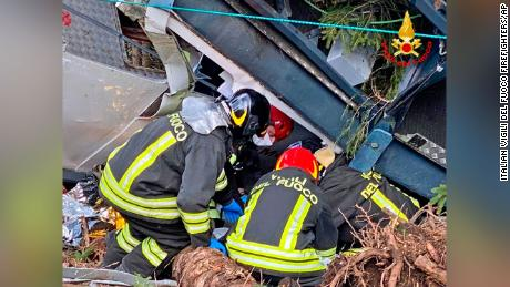 Rescuers work at the crash site.