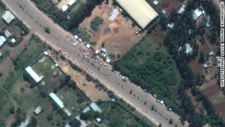 In this satellite image taken on 27 May, crowds are seen outside the Guna distribution center on the outskirts of Shire, Ethiopia.  The detainees say they were beaten and tortured at the facility.