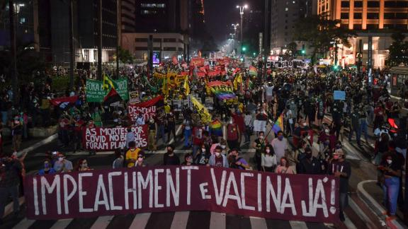 Demonstrators take part in a protest against Brazilian President Jair Bolsonaro's handling of the pandemic in Sao Paulo.