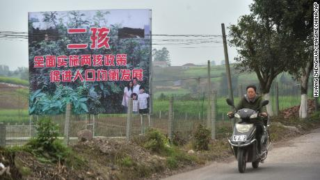 A signboard promoting China's two-child policy in Neijiang, China, on March 23, 2017.
