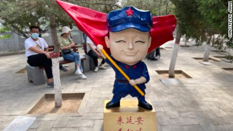 """A cartoon character in Yan'an, a """"red site"""" in northern Shaanxi province, which advertises a stage extravaganza on the Communist Party's early days."""