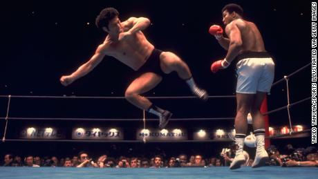 Inoki in action against Muhammad Ali during an exhibition match.