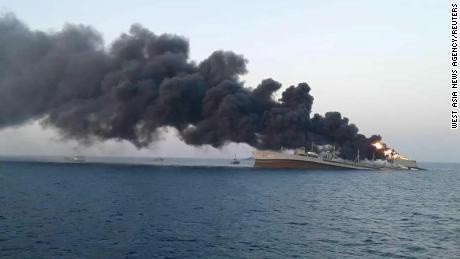 Smoke rises from the stricken navy ship 'Khark' off the Iranian port of Jask.