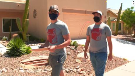 Calden Rasmussen, left, is one of dozens of volunteers seeking signatures to recall Arizona state Rep. Mark Finchem.