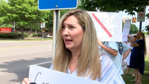 Amy Facchinello takes part in protests supporting her before a school board meeting.