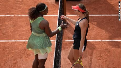 Williams goes to hug Collins after she defeated her in their third-round match.