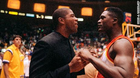 """Basketball legend Earvin """"Magic"""" Johnson is pictured at a Los Angeles Lakers game on November 17, 1991, shortly after announcing he had HIV."""