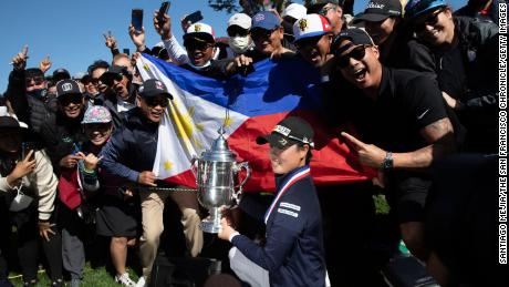 Saso celebrates with the Harton S. Semple trophy after winning the 76th US Women's Open.