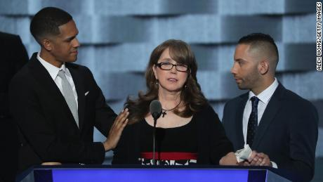 Christine Leinonen, mother of Christopher Andrew Leinonen, is comforted by Brandon Wolf (left) and Jose Arriagada (right), survivors of the Pulse massacre.