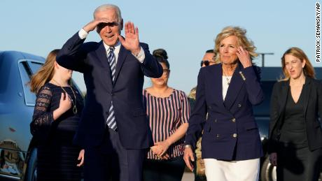 President Joe Biden and First Lady Jill Biden walk on a motorized vehicle after disembarking from Air Force One at RAF Mildenhall on Wednesday, June 9, 2021 in Suffolk, England.