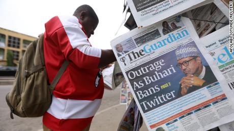 A man reads a newspaper at a newsstand in Abuja, Nigeria. REUTERS/Afolabi Sotunde
