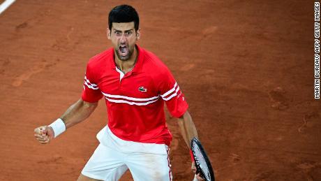 Novak Djokovic rejoices after winning against Italian Matteo Berrettini at Roland Garros.