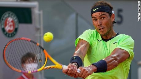 Spaniard Rafael Nadal sends Serbian Novak Djokovic a backhand during the Roland Garros semifinal.