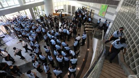 Hong Kong police on Thursday arrested executives and top editors at Apple Daily, and seized journalistic materials as part of the city's national security law.