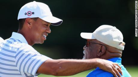 Tiger Woods with Sifford during a practice round of the World Golf Championship Bridgestone Invitational in 2009.