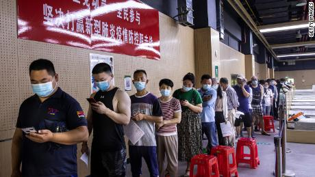 Residents line up at a vaccination site on June 9 in the city of Wuhan, China.