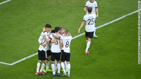 German players celebrate scoring against Portugal.